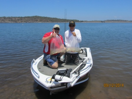 Peter Fogarty and Allan Price release 8000 bass fingerlings into Glenbawn Dam